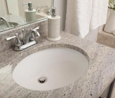 ovale undermount bathroom sinks with marble tiles