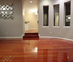 red wood hardwood floors with grey wall