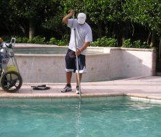 rubbing the pool wall for maintenance swimming pool