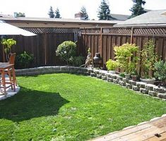 small backyard landscaping ideas with wooden fence