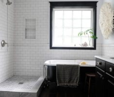small bathroom with black and white bathroom tiles