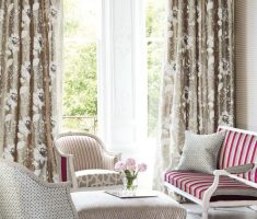 small livng room with modern window treatments and beautiful floral curtain