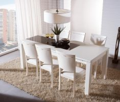 small white dining table and chairs on appartment