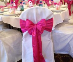 white and pink folding chair covers