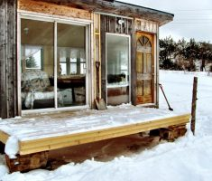 wooden shanty ice fishing house with terrace