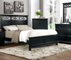 black and white bedroom and wood furniture