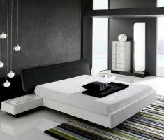 black and white bedroom floating white bed with unique chandelier and strippes rug
