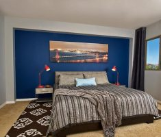 masculine-bedroom-for-men-with-blue-wall-decor-and-black-curtain
