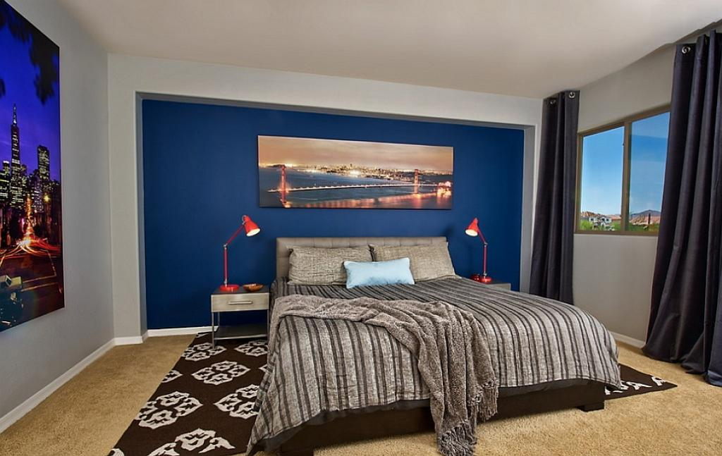 Masculine bedroom for men with blue wall decor and black - Mens bedroom wall art ...