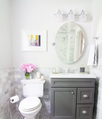 white-and-grey-small-batrhoom-remodeling-theme-and-storage-with-oval-mirror