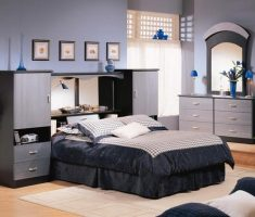 black bedroom with mirrored headboard bedroom set