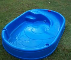 blue plastic garden pool with slide built in
