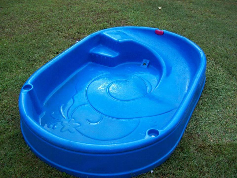 blue-plastic-garden-pool-with-slide-built-in