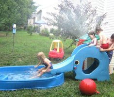 cheerful plastic garden pool with slide
