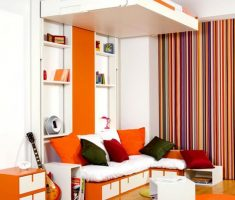 cheerful living area for kids small space decoration with orange theme colors