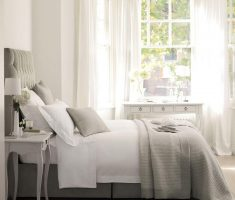 comfortable gloss white bedroom furniture and grey bed