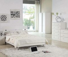 comfortable gloss white bedroom furniture with bold white rug and white hardwood flooring