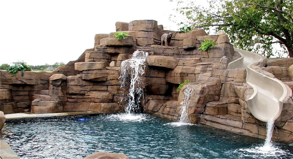 Pools With Slides creative-inground-swimming-pools-with-slides-with-diy-rocks-wall