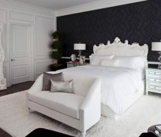 enchanting black and white bedroom theme with white rug and black floral wallpaper