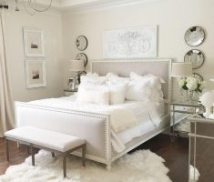 enchanting gloss white bedroom furniture with bold white rug and ottoman