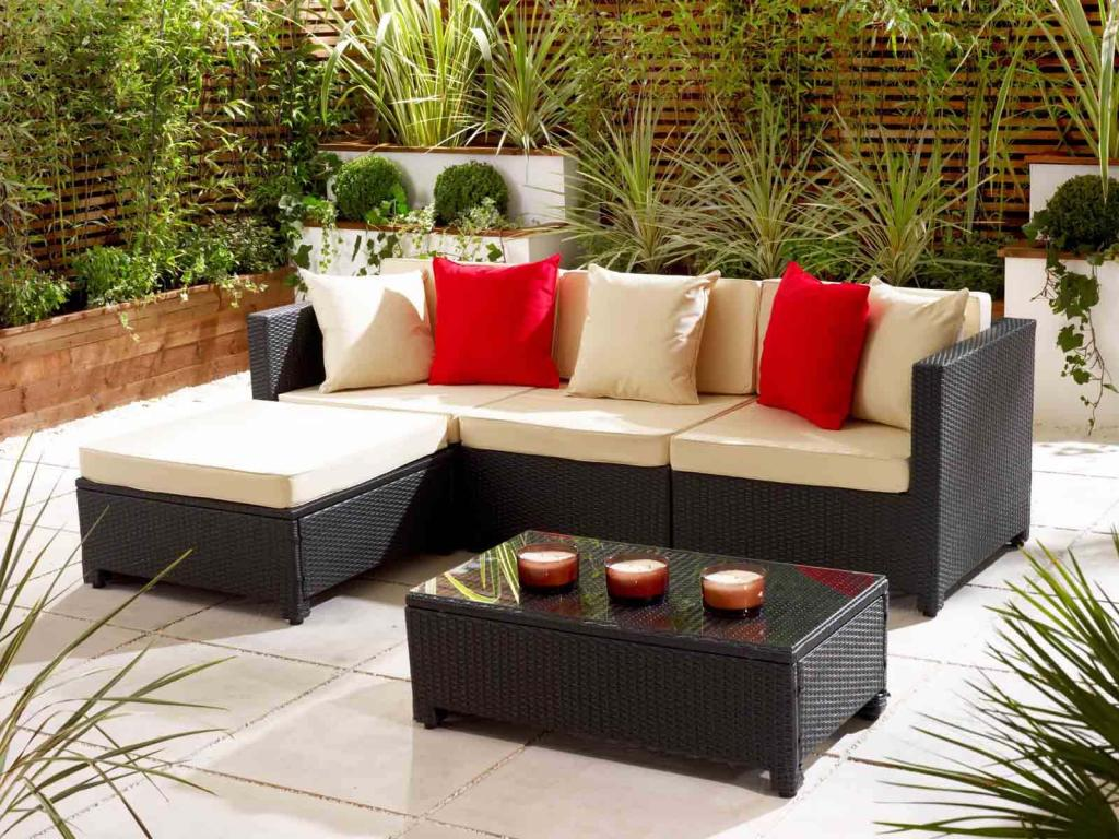 enchanting-rattan-sofa-with-red-and-white-pillow-with-ottoman