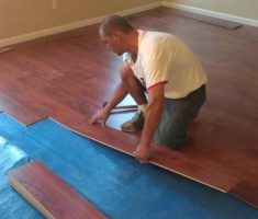 laminate flooring installation with red hardwood