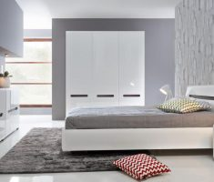 modern gloss white bedroom furniture with grey rug