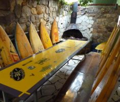 recycled restaurant furniture from surfer board material