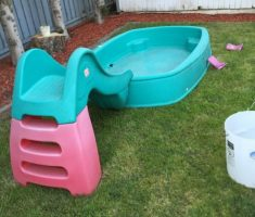 small slide on hard plastic plastic garden pool