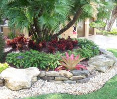 stylish small landscaping ideas for front yard with pebbles and plantings