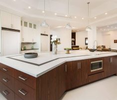 white ultra modern kitchen with bing long kitchen island with drawers