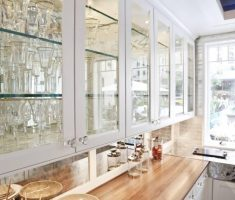white cabinet kitchen design with glass