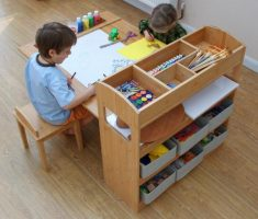 wooen children art tables and desks with cabinet racks of book and colors of pen