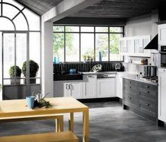 Black and White Apartment Kitchen with Light Grey Hardwood Flooring