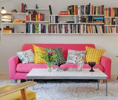 neat and comfortable pink sofa reading chair with diy bookshelves for cheap apartment decorating ideas