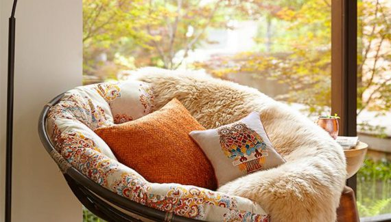 Adorable and Comfortable Reading Papasan Chair with Rattan Material with Copper Floor Lamp