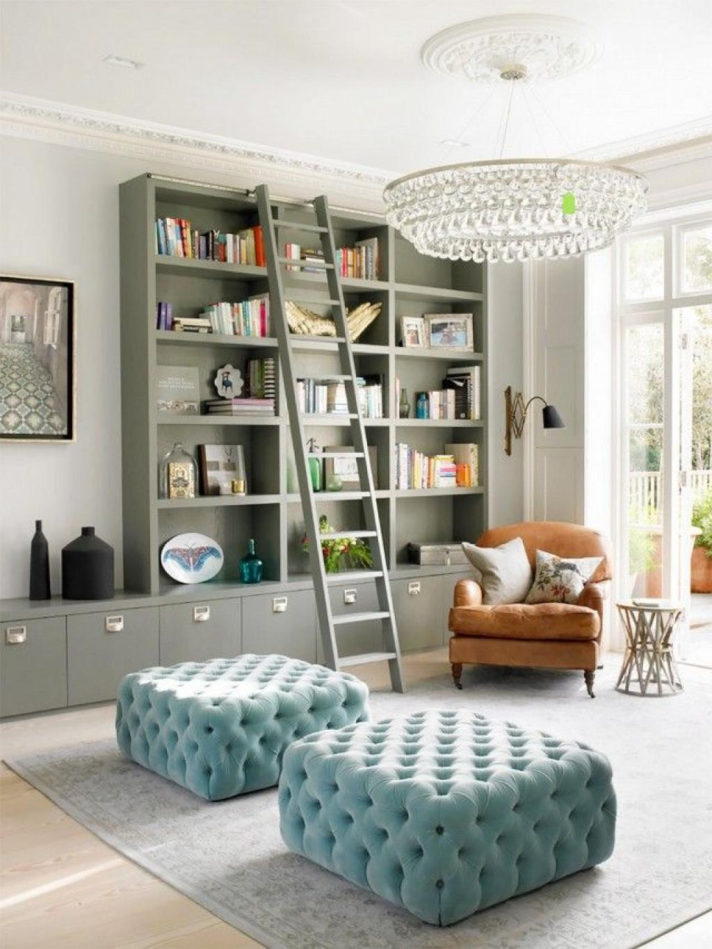 Amazing Reading Room with Comfy Leather Reading Chair and Modern Tufted Blue ottoman and Glass Chandelier