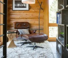 BIg Boss Leather Reading Chair with White Rug Carpets on wooden house