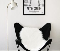 Minimalist Black Butterfly Reading Chair with White Fur Blanket with Minimalist Floorlamp