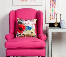 Pink Reading Chair with Stripped Black and White Carpet Rug