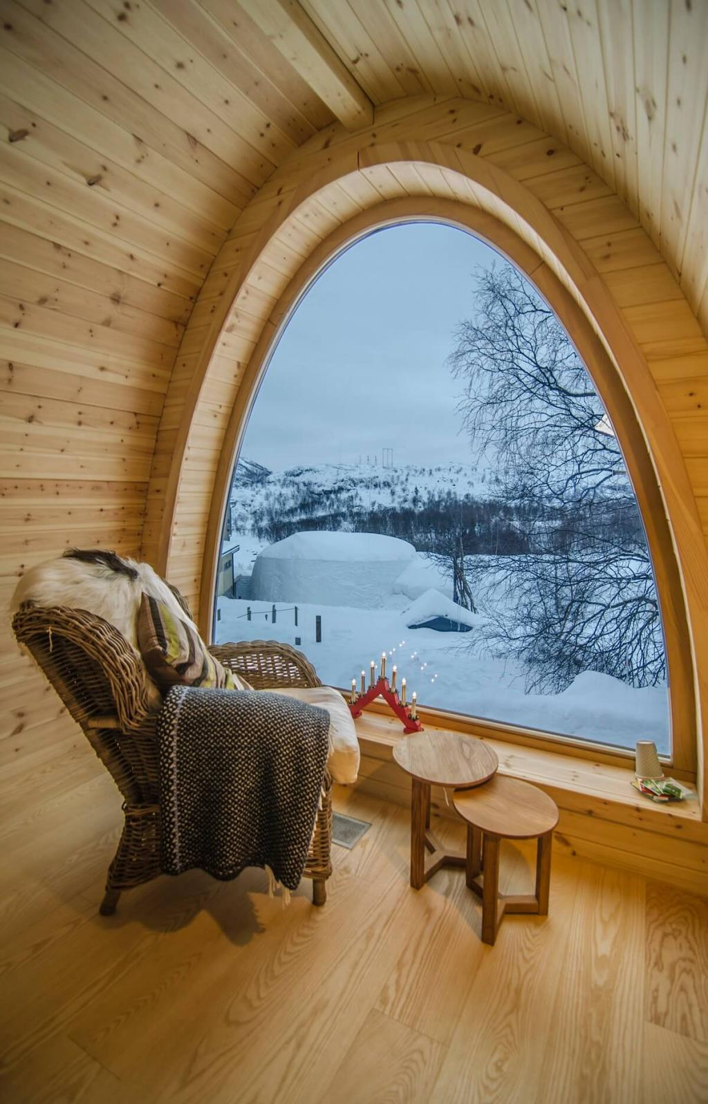 Simple Rattan Reading Chair in Wooden Winter House windows