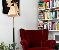 Wonderful Deep Red Velvet Corner Reading Chair with 5 Layer of Wall Bookshelf