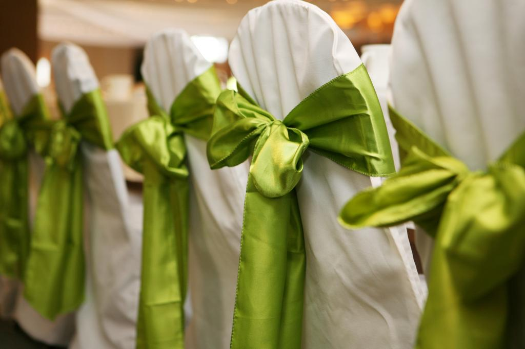 enchanting-bridal-white-folding-chair-covers-and-green-lime-ribbons